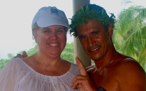 Can't puplish the fullsize version of the photo.  I am totally soaked by the rain.  But that didn't stop me from taking a photo with a cute Tahitian bellhop.  When not being photographed, I wore my backpack in front to cover the white-now sheer-white top.