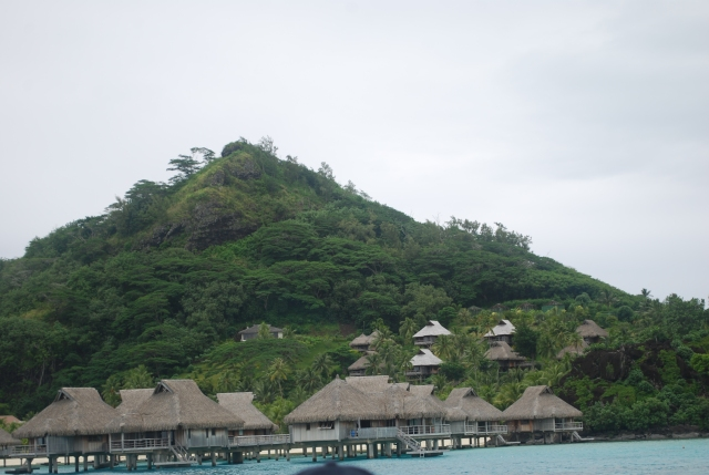 Traditional Bungalows on the water found as hotel accommodations throughout French Polynesia©Jean Janssen