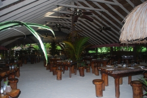 Interior of Bloody Mary's on Bora Bora built in the traditional Polynesia style.  It even has a sand floor.©Jean Janssen