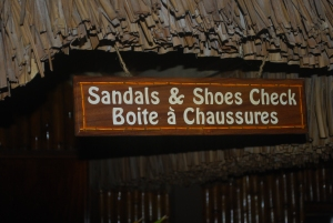 You would never need a coat check in Bora Bora, but with sand floors I guess a shoes and sandals check is a necessity.  Bloody Mary's in French Polynesia.©Jean Janssen