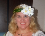 I braided this headband out of palm leaves and added the local flowers with the assistance of an islander. In Rangiroa, Tuamotu Islands, French Polynesia
