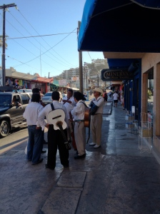 Only in Mexico do you find mariachi bands hanging out in town.  Cabo San Lucas, Baja, Mexico. ©Jean Janssen