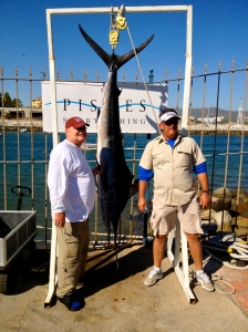 Boris and Fred with their striped marlin.  Cabo San Lucas marina, Mexico.©Jean Janssen