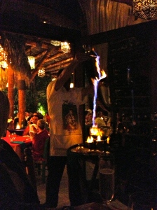 Make sure someone in your group gets the flaming Mexican coffee so you don't miss the show.  In the wine room at Edith's in Cabo San Lucas.©Jean Janssen