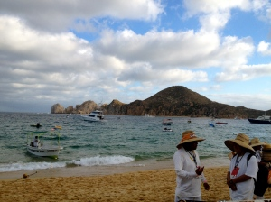 Beach vendors and boat in the bay at Cabo San Lucas.©Jean Janssen