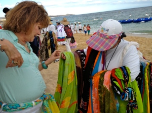 Margaret does a little bargaining  on the beach and comes away with a colorful sarong.©Jean Janssen