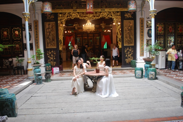 "Courtyard in the Pinang Peranakan Mansion.   These four ""sorority"" girls in white dresses had hired a photographer to take pictures of them in the Pinang Perkanakan Mansion ©Jean Janssen"