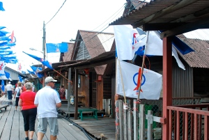 Along the jetty in Penang.  Note the plumbing lines and the political flags out for Nomination Day.