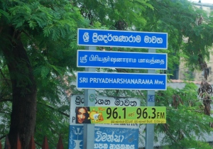 Street in three languages.  Sinhalese on top, then Tamil, then English.  In Sri Lanka. ©Jean Janssen