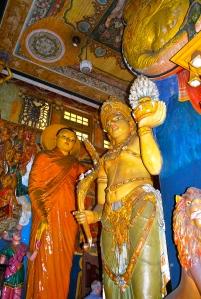 Three story Budda statutes.  Note man head to realize size.  At the Gangaramaya Temple, Colombo, Sri Lanka. ©Jean Janssen