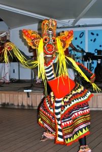 Sri Lankan dance troupe member wearing a ritual mask. ©Jean Janssen