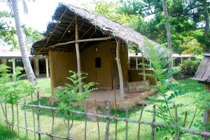 Former village life home in Sri Lanka.  The mother and children stayed inside while father slept on porch.  Note that porch is 3/4 of the home.  At the Martin Wickramasinghe Museum of Folk Culture in Koggala, Sri Lanka. ©Jean Janssen