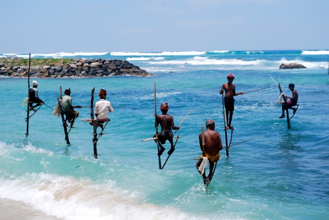 Stilt fisherman in the Indian Ocean at Galle, Sri Lanka. ©Jean Janssen