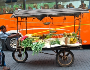 This is where you get those fresh fruits and vegetables.  Love the twist with the bus in the background. ©Jean Janssen