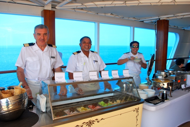 Theo, on the left, was one of the senior officers on the Amazara Journey who served gelato on the pool deck to guests.  There is a lot of interaction between the officers and guests, the most I have ever seen on a cruise ship. ©Jean Janssen