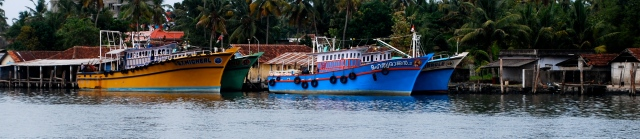 Named fishing boats at Kochi, India.  Note one is St. Michael.  The other has a picture of Jesus.  Names are reflective of the owner's religion. ©Jean Janssen