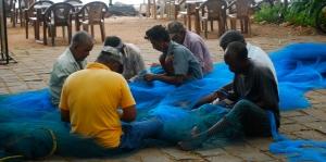 Repairing fishing nets.  Fort Kochi, India. ©Jean Janssen