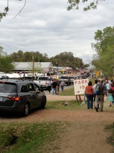 The road was backed with shoppers and vendors heading in both directions.  Warrenton, Texas.©Jean Janssen
