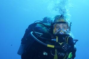Debbie Fuqua models the amazing masks that allow Debbie and her buddy Bill to talk underwater.  ©Bill Fuqua