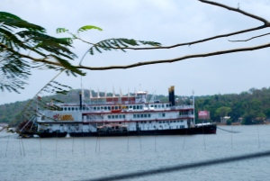 Riverboat Casino in Panaji, Goa, India.  The bamboo sticks in front are used to attach a net for fishing. ©Jean Janssen