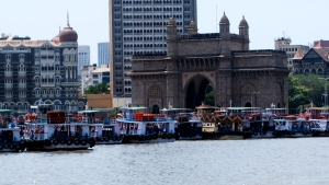 The Gateway of India from the water with some of the colorful boats to Elephanta Island. ©Jean Janssen