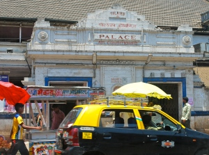 """The Palace Theater, one of the original movie theaters in Mumbai.  Notice the reference to """"talkies"""" at the top. ©Jean Janssen"""