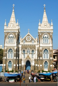 Mount Mary Basilica, Bandra, India.  People of all faiths come here on pilgrimage to seek help or give thanks for it.  In front, vendors sell garlands of flowers and candles to give as an offering. ©Jean Janssen