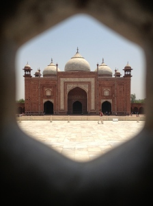 View of Taj Mahal guesthouse as seen through the lattice work window coverings in the Taj Mahal. ©Jean Janssen