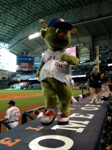 Orbit struts his stuff on the catwalk, aka the roof of the Astros' dugout. ©Jean Janssen
