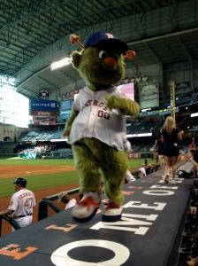 Orbit struts his stuff on the catwalk, aka the roof of the Astros' dugout. ©Jean Janssen