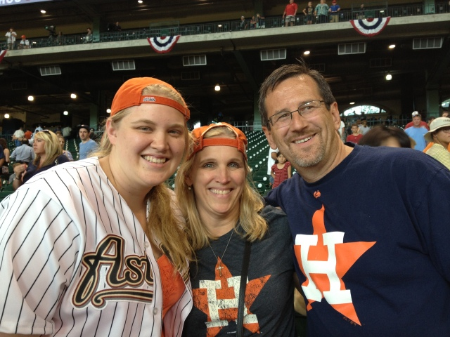 Maggie, Emma, and Dudley sport Astros gear for the game. ©Jean Janssen
