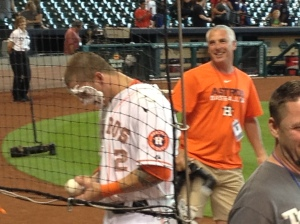 A class act.  Astro Brandon Barnes continues to sign the fans' baseballs after a pie in the face. ©Jean Janssen