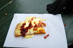 One of the tasty treats we tried at the Passau Christmas Market.  Melted cheese on top of rye bread and then you add your own topping.  We tried half berries (sweet) and half speck (salty).  Ok, I admit it.  I had already eaten some when I remembered to take the picture. ©Jean Janssen