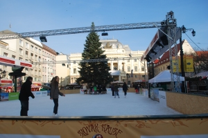 Ice skating rink in front on the Opera House in Bratislava, Slovakia.  Note the large Christmas tree on the ice surrounded by wooden benches that the skaters rested on. ©Jean Janssen