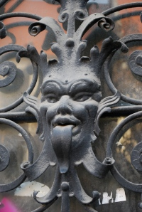 Ugly or scary figures were often found on the outside of house to protect against evil spirits.  These are on the doors of one of the unrenovated buildings in the old city of Bratislava. ©Jean Janssen