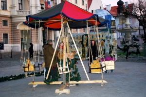 Child's swing ride in the Opera House Market in Bratislava.  The ride is operated by a hand crank. ©Jean Janssen