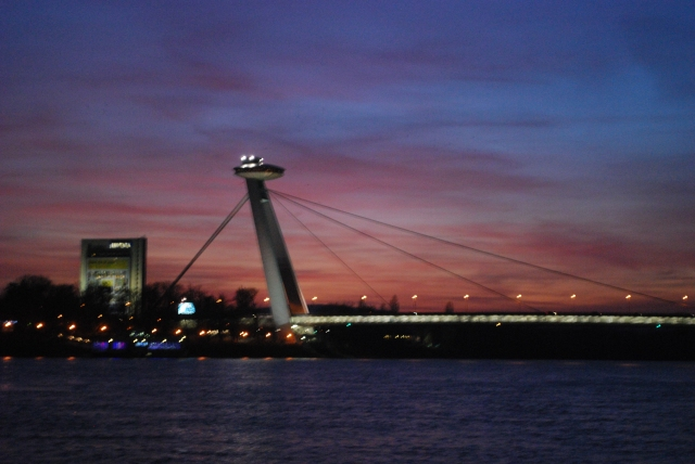 The Suspension bridge in Bratislava, Slovakia at sunset as seen from our cabin aboard the River Beatrice, Uniworld. ©Jean Janssen