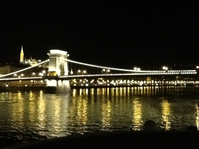 The Chain Bridge with St. Matthais Church in the background as we cruised out of Budapest at night. ©Jean Janssen