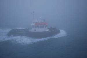 Pilot boat in the morning fog, East London, South Africa ©Jean Janssen