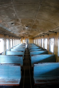 Interior of the train cars still used at the Maputo station.  Nothing seemed to be updated.  If the window breaks, they just leave the pain empty. ©Jean Janssen