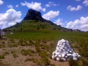 The battle site at Isandlwana.  The cairns mark the spot of burial of the British soldiers.