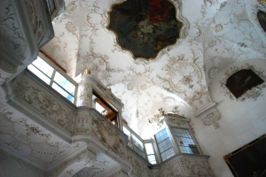 The Arbishop's second floor seat and the painted ceiling of the chapel in Schloss Leopoldskron.  The chapel is among the public rooms open to guests of the Hotel. ©Jean Janssen