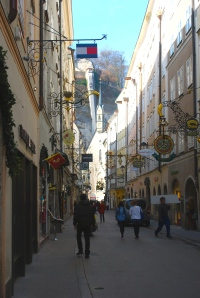 Salzburg's major shopping street, Getreidegasse with its wonderful iron work signs. ©Jean Janssen