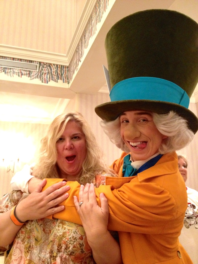 The Mad Hatter gives Natasha a big hug at the Grand Floridian's character breakfast at Park Fare, WDW.