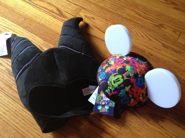 Both Rocky and I have been to Disney many times and we both love hats so we limited our souvenirs to these two special items-the new light-up ears to go with nighttime disney shows and some Maleficent horns to wear to the movie premier this week. ©Jean Janssen