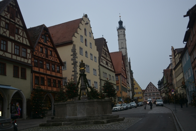 View toward Marktplatz from Herrngasse with the Herrenbrunnen (gentry well) in the foreground.   Rothenburg, Germany ©Jean Janssen