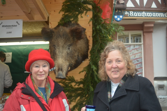 Susan and Janet pose with the Wild Boar at our sausage booth.  Wertheim, Germany ©Jean Janssen