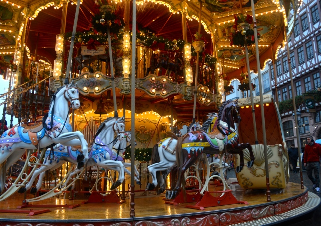 Traditional Carousel with a single dark horse, Christmas Market, Frankfurt, Germany ©Jean Janssen