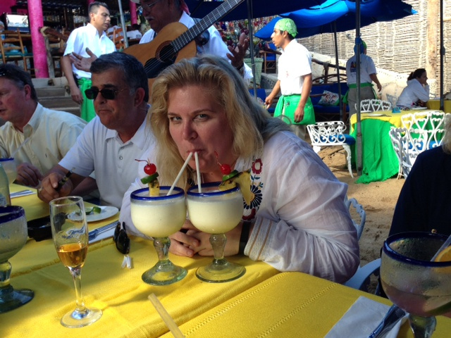 Natasha enjoying her pina coladas and tequila (in the champagne flute) at the Office, Cabo San Lucus--photo by Terry Baca