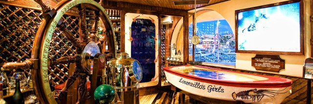 The small fishing boat is the live lobster hold at Lorenzillo's in Cabo San Lucas.